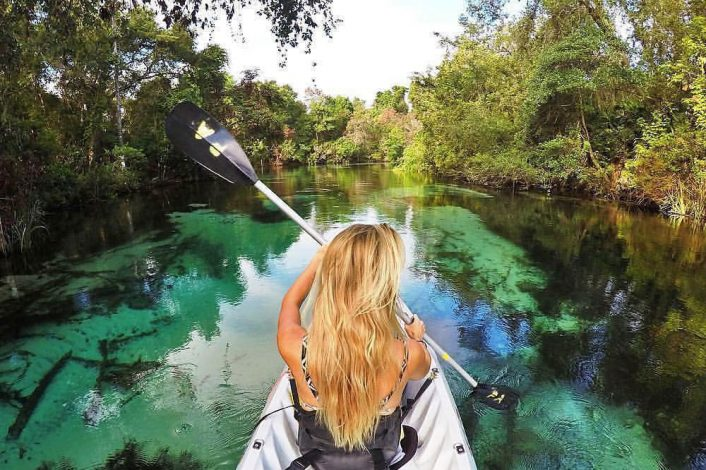 girl paddling in weeki wachee