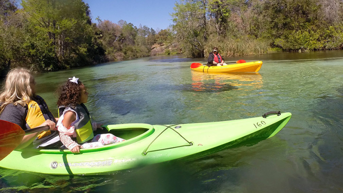 photo of people kayaking on weeki wachee springs river